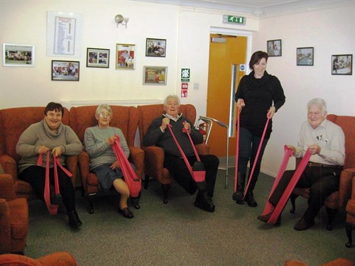 Chair Based Exercise Group Led By Volunteer